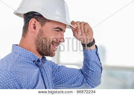 Attractive young builder is preparing for work