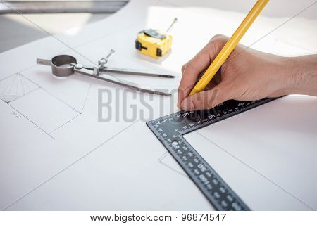 Successful young architect is working on the project