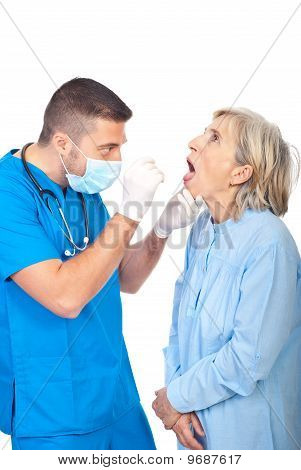 Doctor Examine Senior Throat