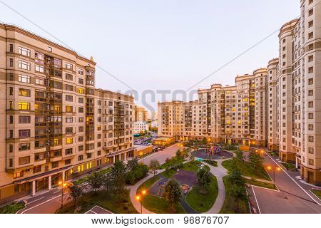 View of Moscow modern residential quarters at sunset on top of the roof of a tall building