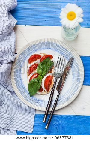 Toast With Cherry Tomato, Mozzarella And Basil Leaves
