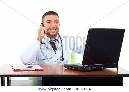 Smiling Doctor On Phone Mobile In Office