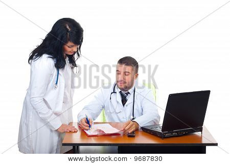 Two Physicians Team In Medical Office