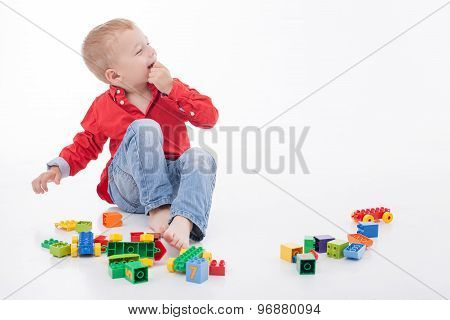 Cheerful male child is having fun with someone