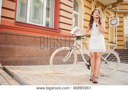 Beautiful young woman is cycling in her town