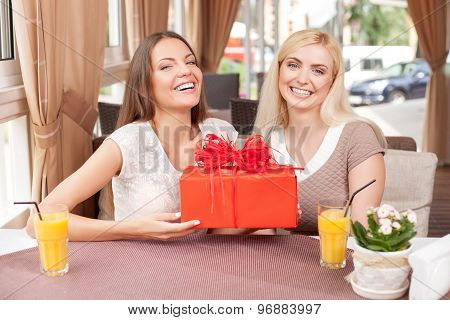 Attractive young girls are celebrating in cafeteria