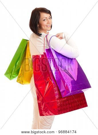 Young smiling woman with bags isolated