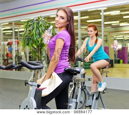Two sporty girls at fitness club