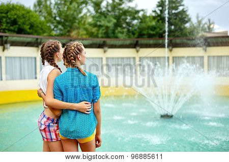 Friendly Hug At The Fountain.