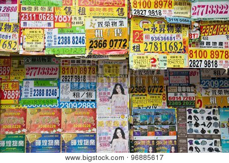 HONG KONG - CIRCA FEBRUARY, 2015: Advertisements on the wall in the bustling district of Hong Kong.