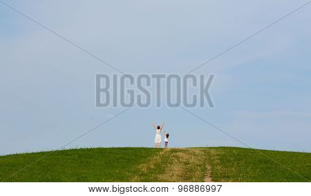 Two person on the top of the hill reached the peak