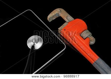 Stethoscope Head, Adjustable Wrench On The Tablet Display Black Isolated
