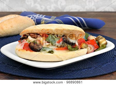 Roasted Vegetable Sandwich On A Sub Roll.