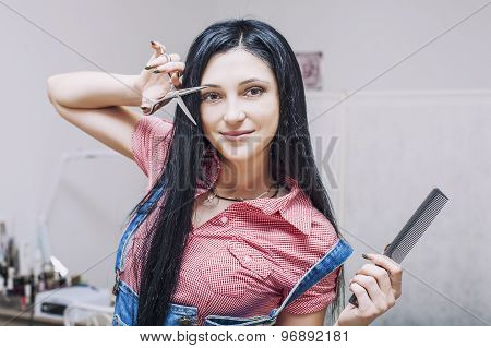 Beautiful Woman Hairdresser At The Beauty Salon With Scissors And Tools In Hand