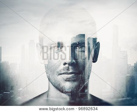 Double exposure  black and white portrait of a handsome man