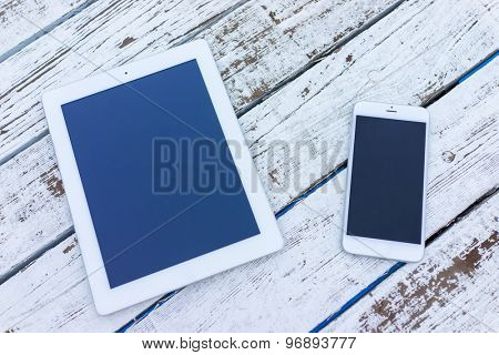 White wood with tablet screen copy space background