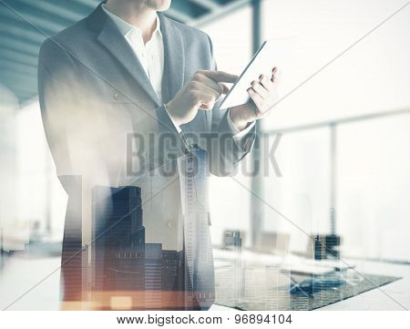 Double exp business man with tablet