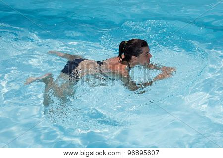 Female Swimmer In An Outdoor Swimming Pool