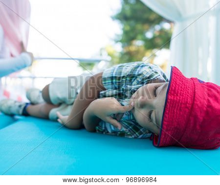 Little boy enjoying on green bed
