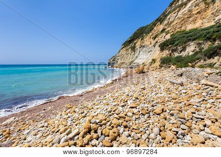 Coast Landscape With Stony Beach And Blue Sea