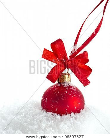 christmas red ball with ribbon bow isolated on snow white background