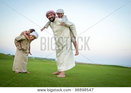 Father and sons in beautiful nature