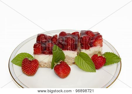 Flan With Fresh Strawberries And Mint Leaves