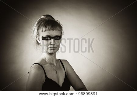 Girl with circus make-up.  Black and white photo