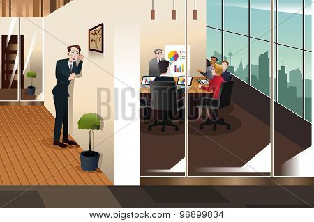 Businessman Listening To The Conversation In A Meeting Room