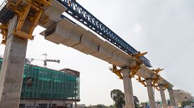stock photo of heavy  - Construction of a mass transit train line in progress with heavy infrastructure - JPG