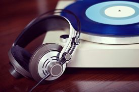 stock photo of analogy  - Analog Stereo Turntable Vinyl Record Player with headphones - JPG