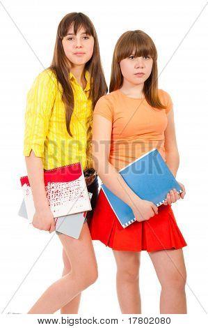 Two Schoolgirls Teenagers With Notebooks