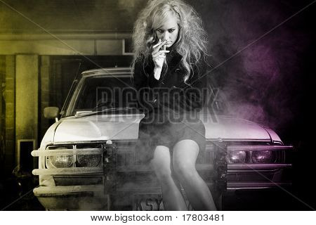 High Fashion Model On Car At Night Smoking