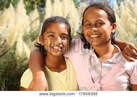 Two young girls in friendship hug