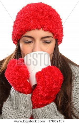 Woman with warm wollies and mug