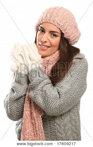 Beautiful happy young woman in winter woollies