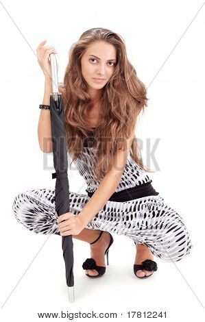 Young Pretty Lady In Harem Pants Posing With Black Umbrella On W