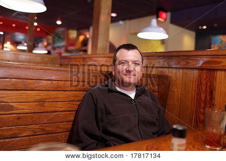 Happy Man At Restaurant