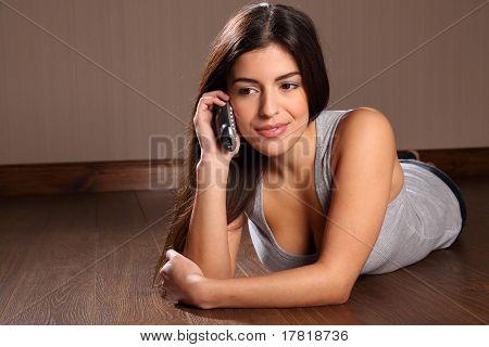 Pretty woman using telephone