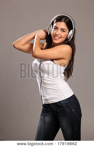 Happy girl dancing to music