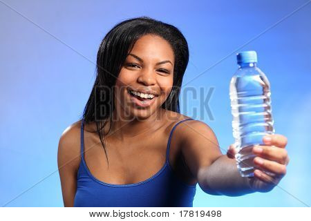 Beautiful Girl Laughing And Holding Bottled Water