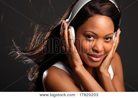 Happy woman wearing headphones
