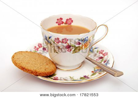 Cup of  Traditional English tea with biscuit on white background