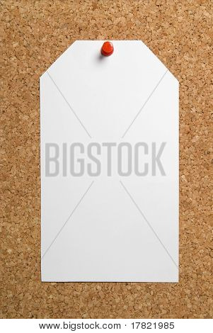 Blank paper tag on cork board background