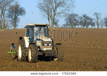 Ploughing an empty field in late winter - UK
