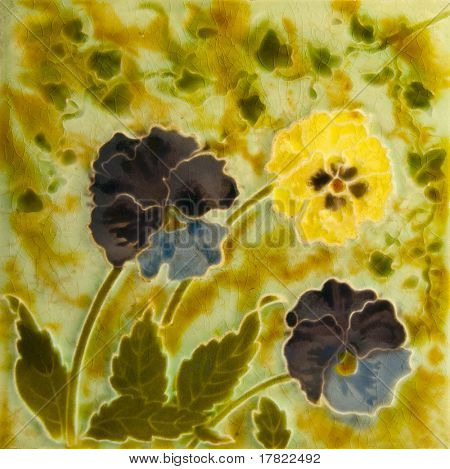 A Victorian Art Nouveau period tile c1890 in majolica glaze with pansy flowers