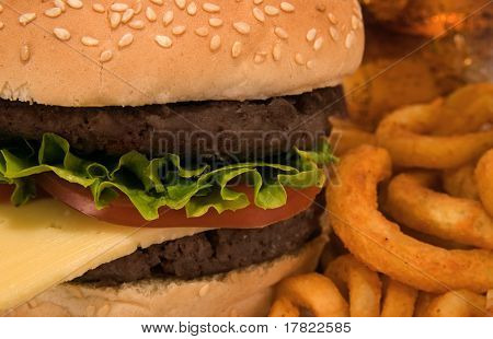 Burger and fries close up with cola in background