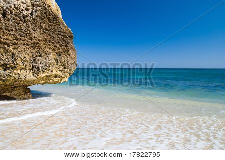 A section of the idyllic Praia da Marinha beach on the southern coast of the Portuguese Algarve region.