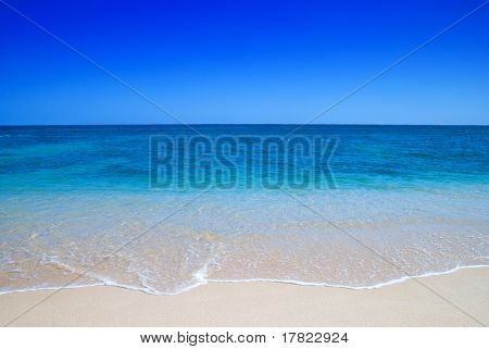 Gentle waves breaking over an idyllic beach
