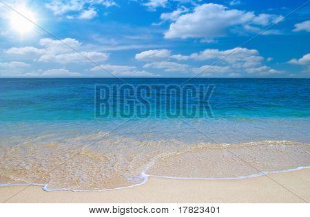 Idyllic beach with summer sky and direct sun